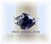 TANZANITE CZ ACCENTED STERLING SILVER RING