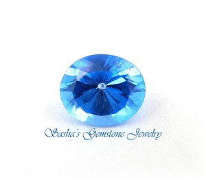 14 X 12 OVAL SWISS BLUE TOPAZ